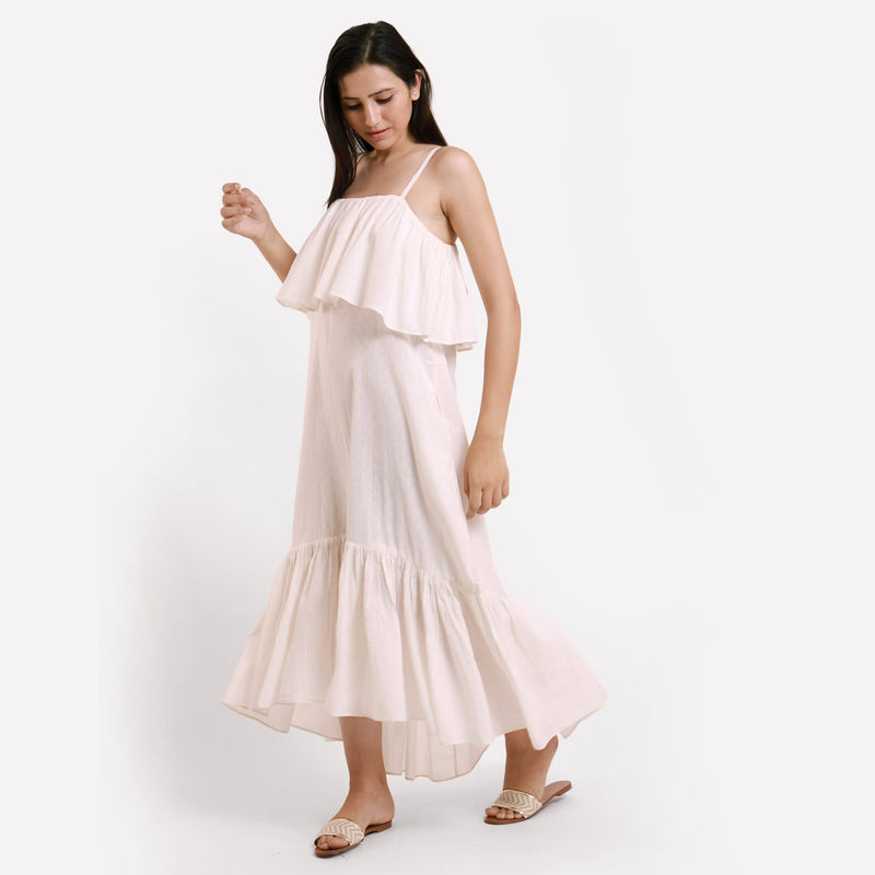 Left View of a Model wearing White Camisole Frill Maxi Dress