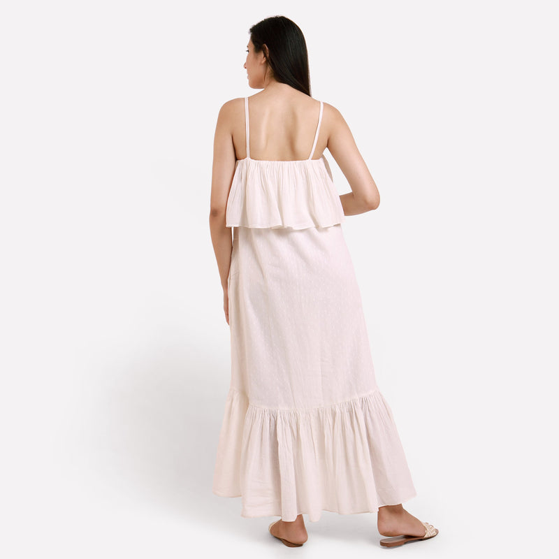 Back View of a Model wearing White Camisole Frill Maxi Dress