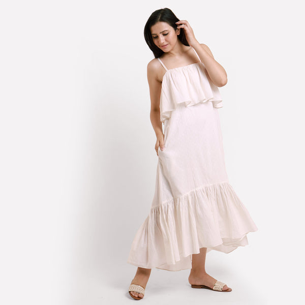 Right View of a Model wearing White Camisole Frilled Maxi Dress