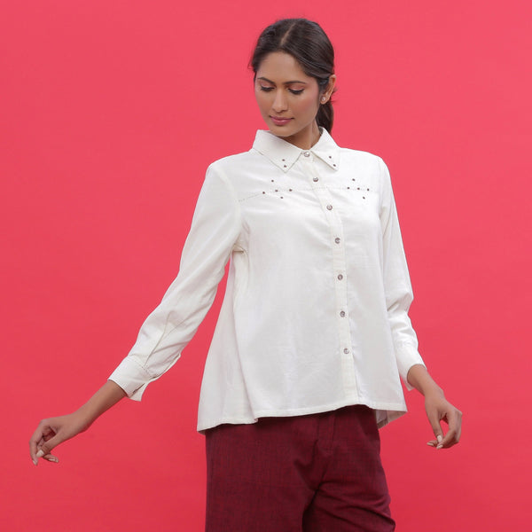 Front View of a Model wearing White Corduroy Hand-Beaded Shirt