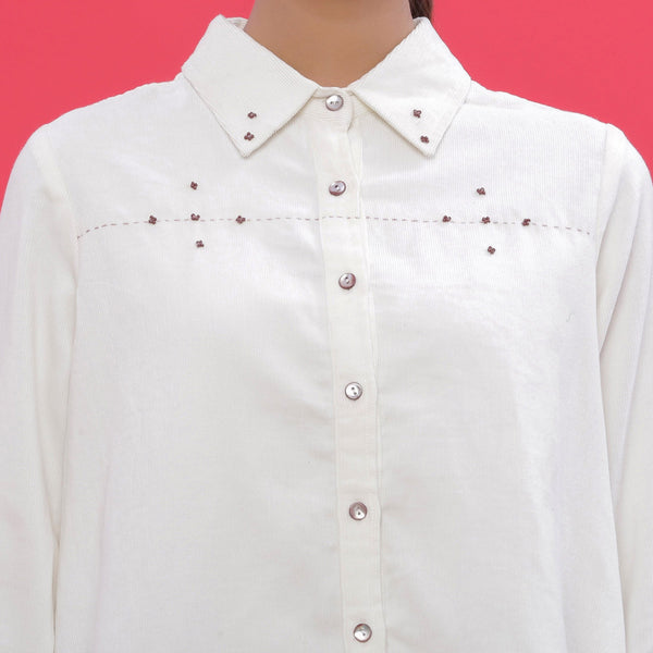 Front Detail of a Model wearing White Corduroy Hand-Beaded Shirt