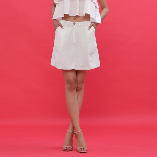 Front View of a Model wearing White Corduroy Hand Embroidered Pencil Skirt
