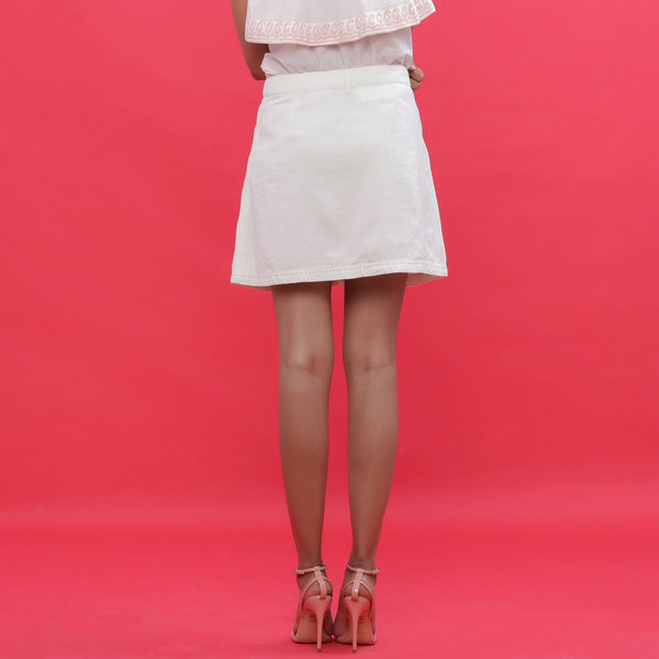 Back View of a Model wearing White Corduroy Hand Embroidered Pencil Skirt