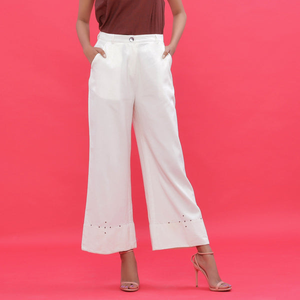 Front View of a Model wearing White Corduroy Subtle Beaded Bootcut Pants