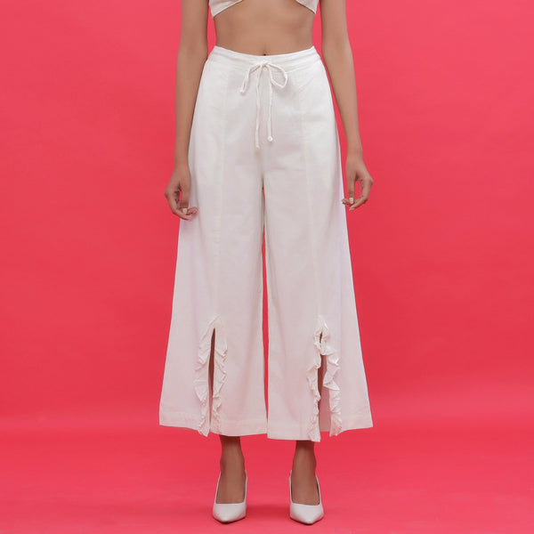 Front View of a Model wearing White Corduroy Wide-Leg Slit Pants