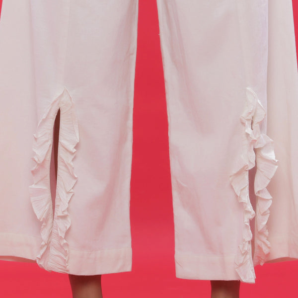 Front Detail of a Model wearing White Corduroy Wide-Leg Slit Pants