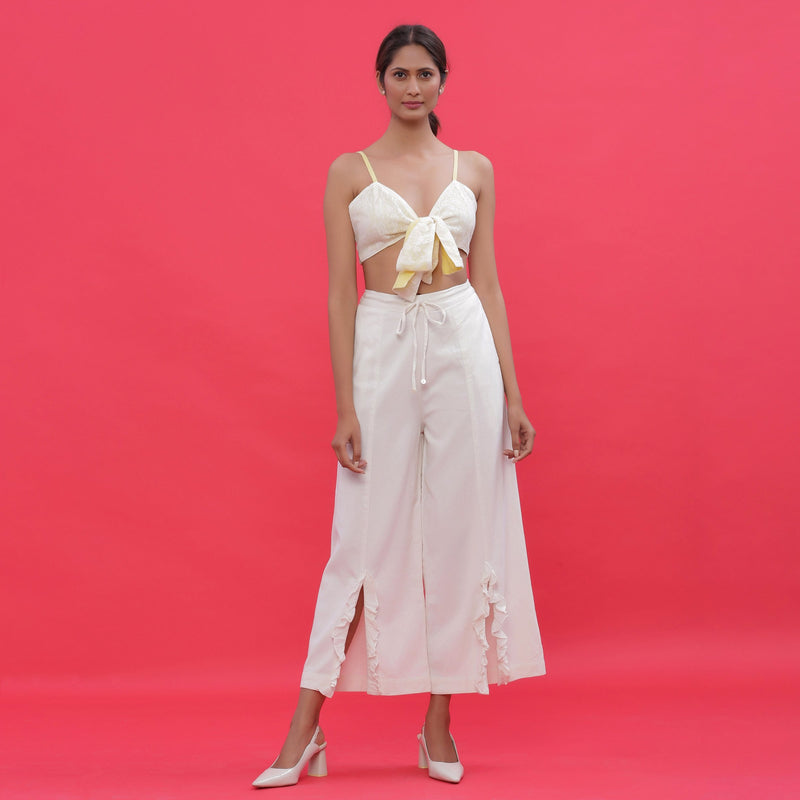 Front View of a Model wearing White Corduroy Slit Wide-Leg Pant