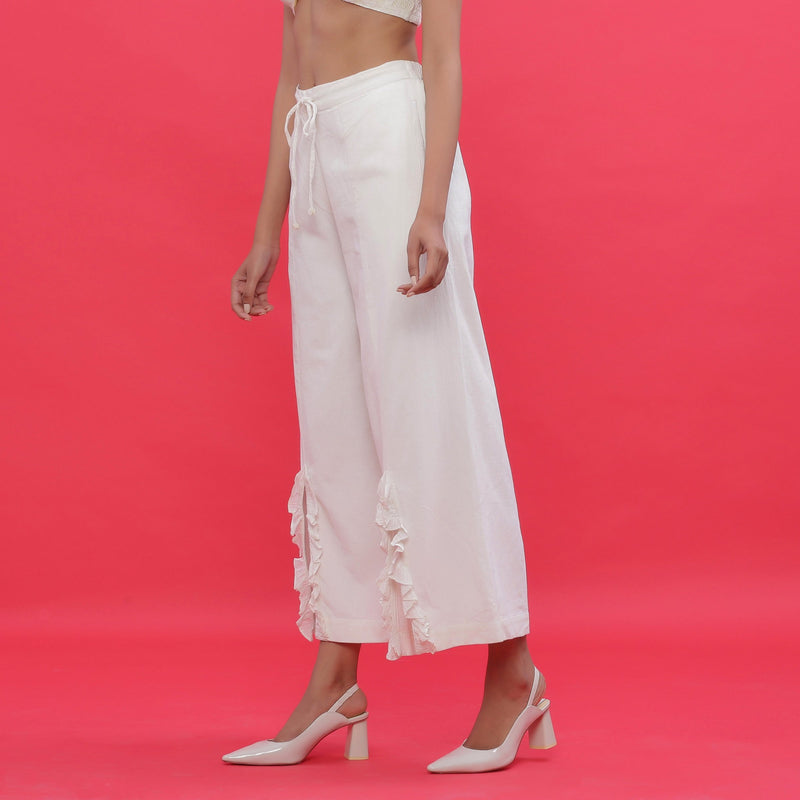 Left View of a Model wearing White Corduroy Slit Wide-Leg Pant