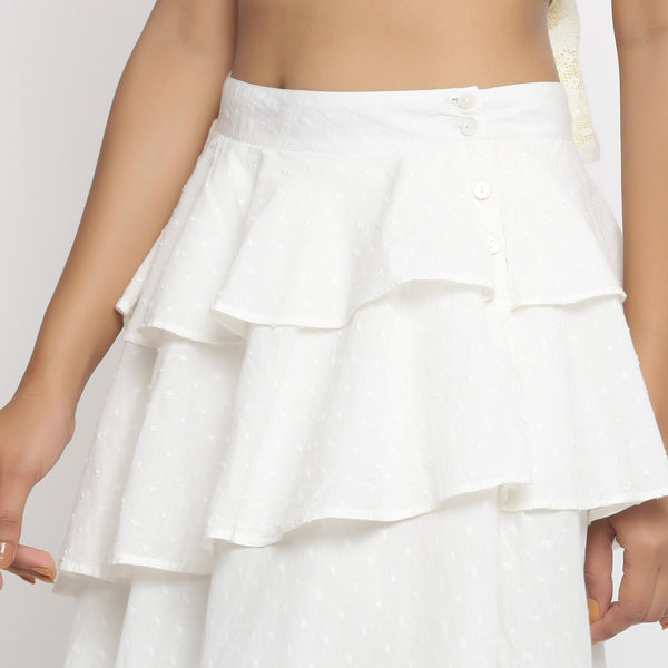 Left Detail of a Model wearing White Cotton Dobby Ruffled Skirt