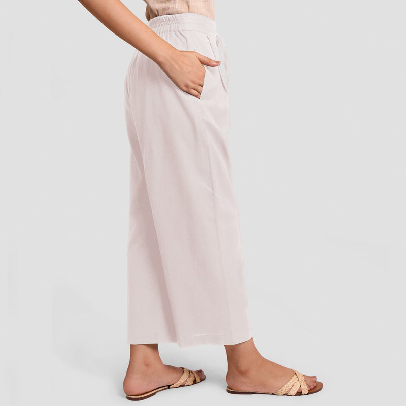 Right View of a Model wearing White Cotton Flax Wide Legged Pant