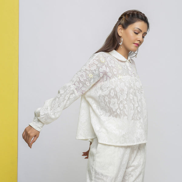Right View of a Model wearing White Cotton Lace Hand-Embroidered Sheer Yoked Top