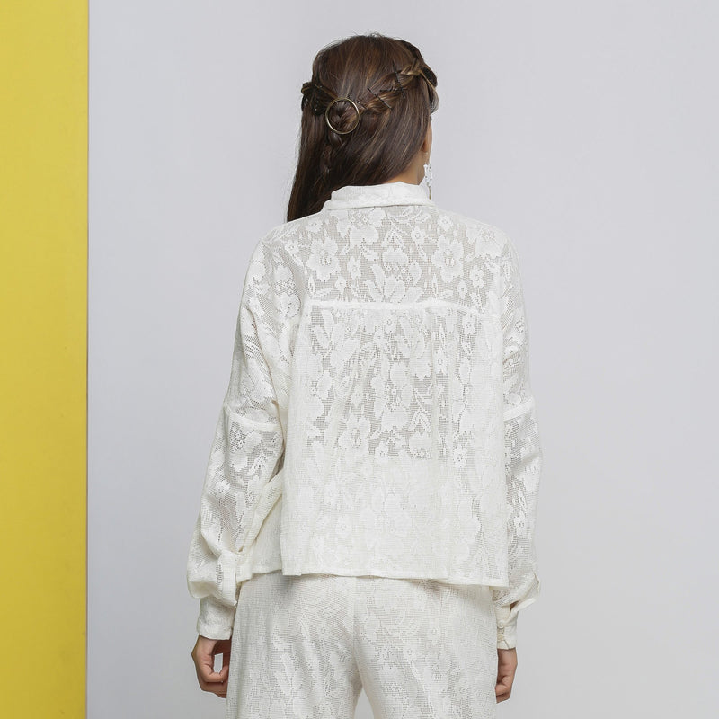 Back View of a Model wearing White Hand-Embroidered Sheer Yoked Top