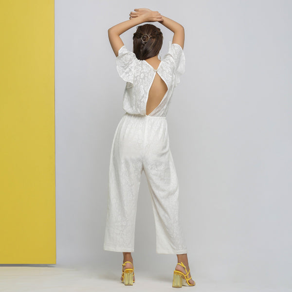Back View of a Model wearing White Cotton Lace Hand Embroidered Jumpsuit