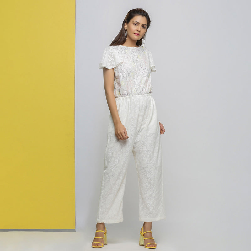 Right View of a Model wearing White Cotton Lace Hand Embroidered Jumpsuit