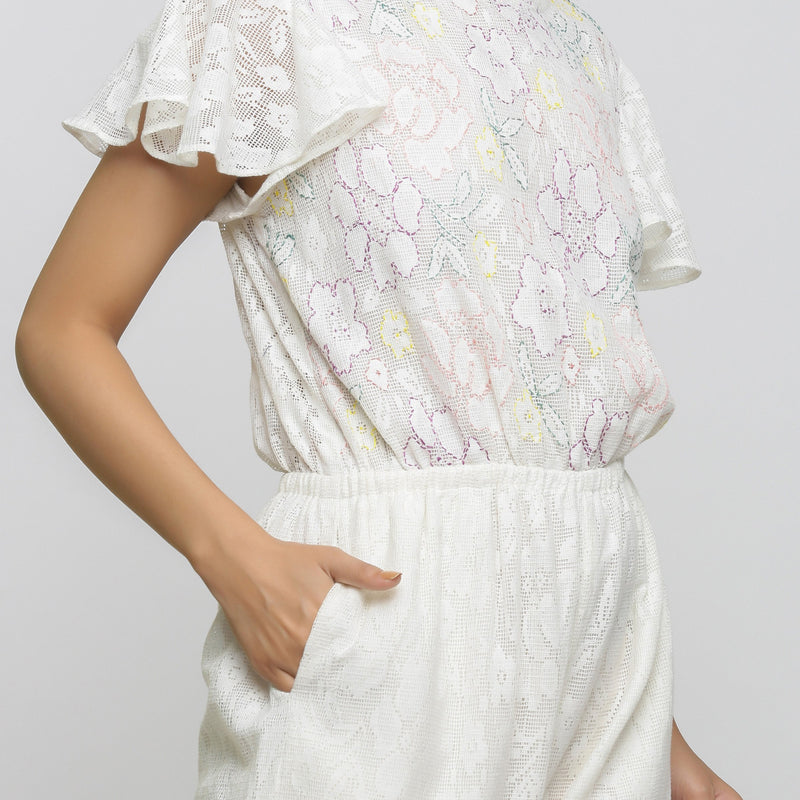 Right Detail of a Model wearing White Cotton Lace Hand Embroidered Jumpsuit