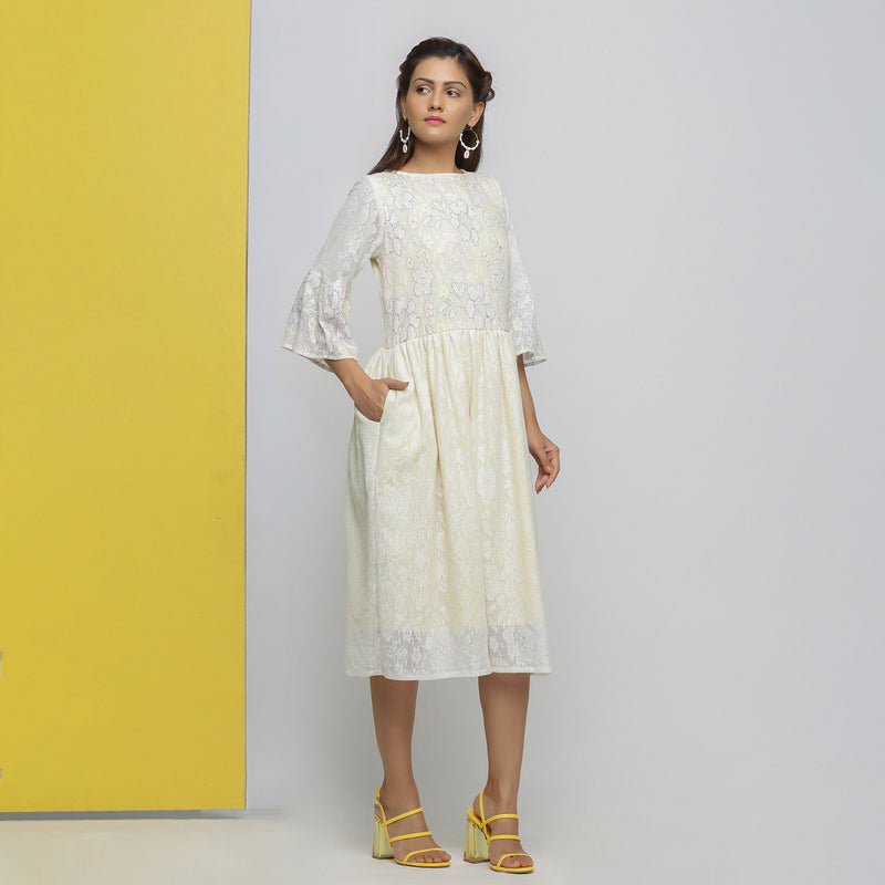 Front View of a Model wearing White Cotton Hand-Embroidered Yoked Dress