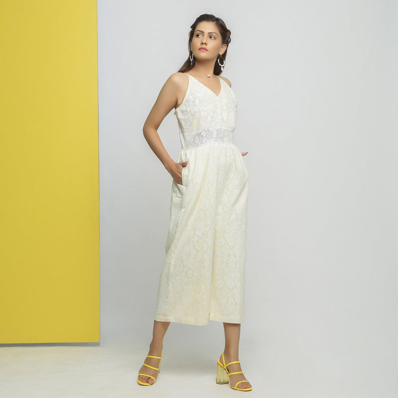 Right View of a Model wearing White Cotton Floral Straight Jumpsuit