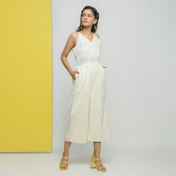 Right View of a Model wearing White Cotton Lace Straight Jumpsuit