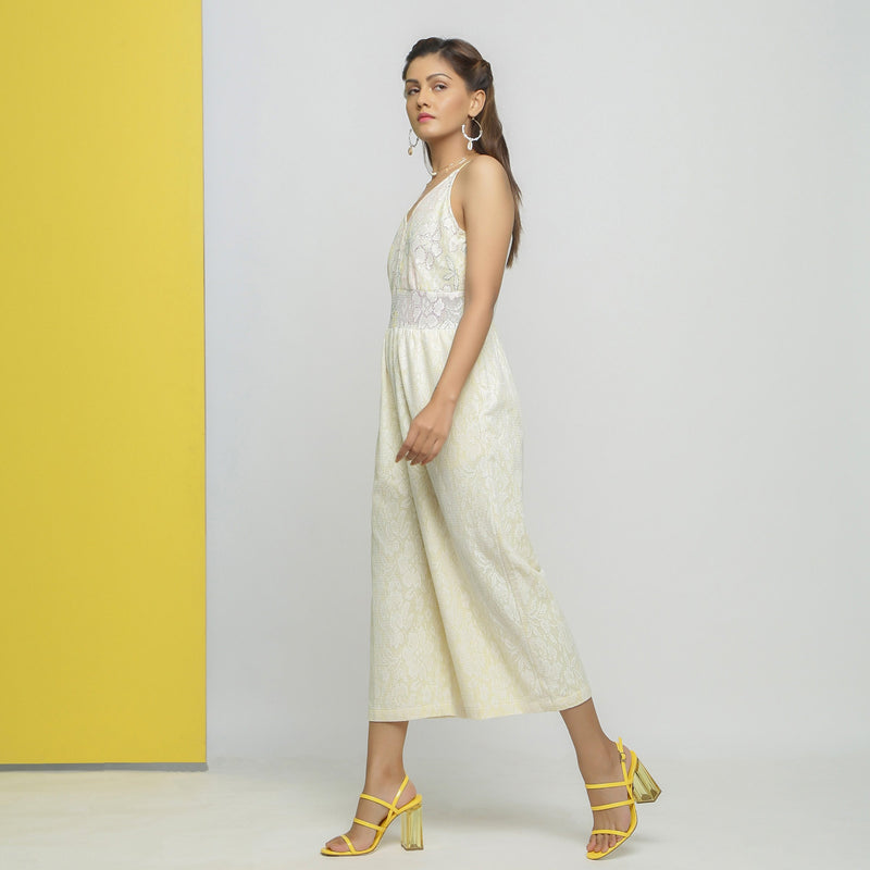 Left View of a Model wearing White Cotton Floral Straight Jumpsuit