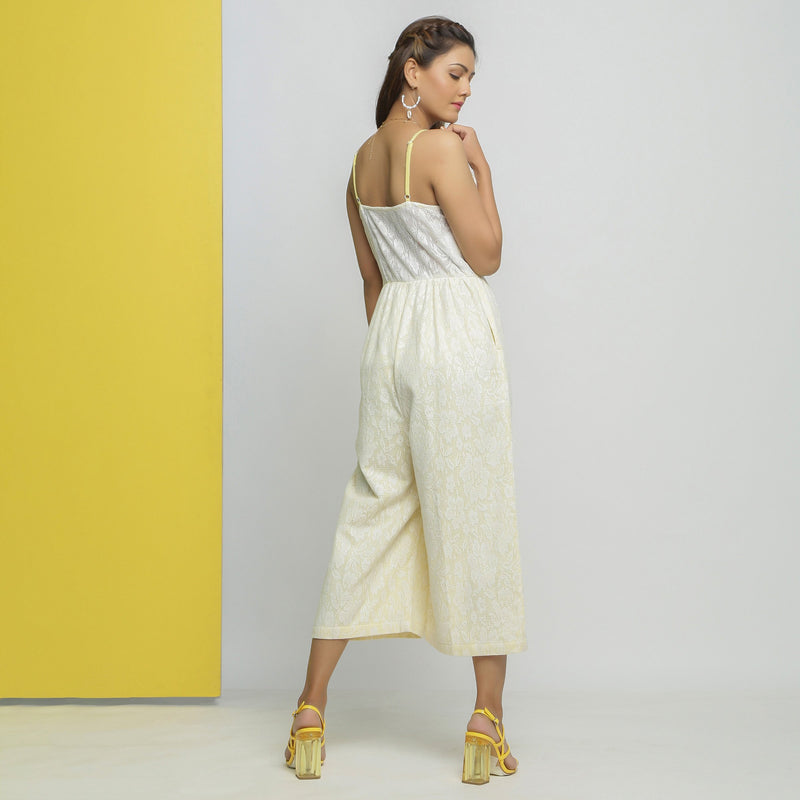 Back View of a Model wearing White Cotton Floral Straight Jumpsuit