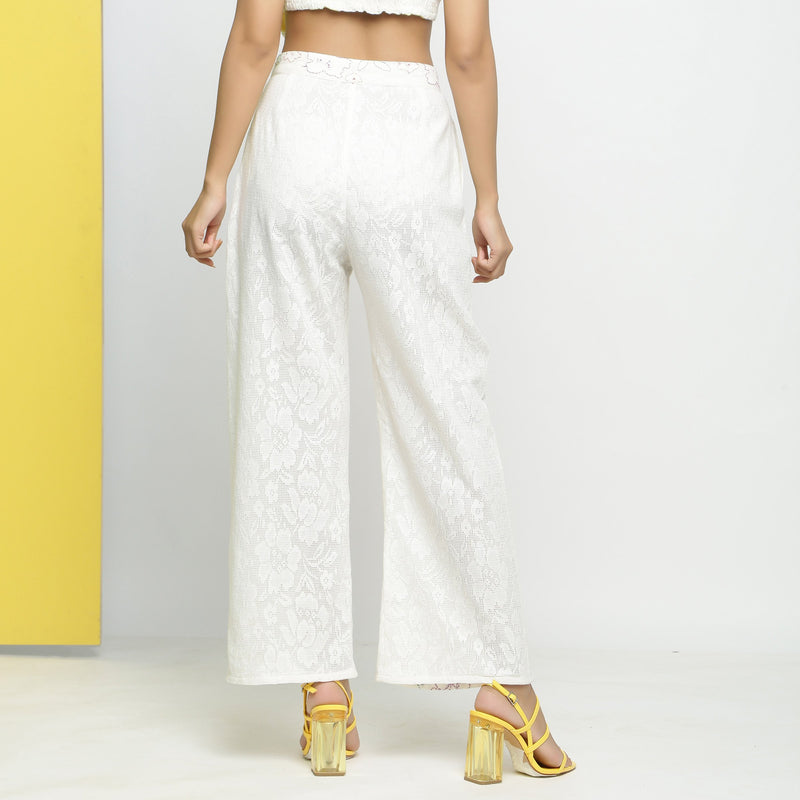 Back View of a Model wearing White Cotton Schiffli Paneled Pant