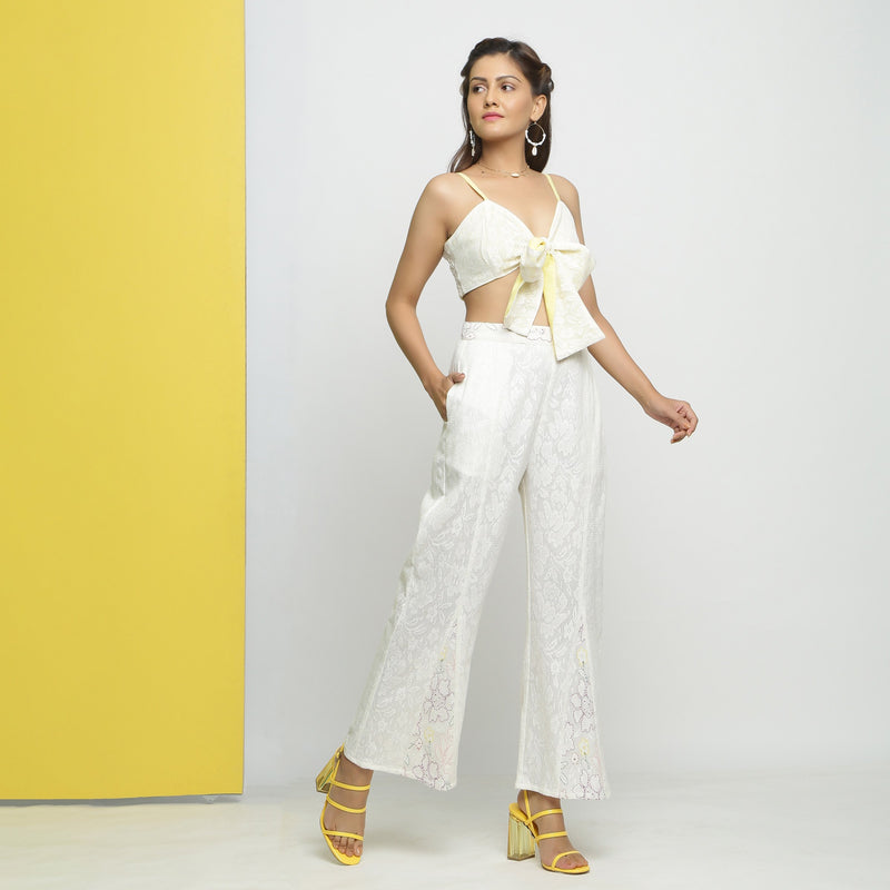 Right View of a Model wearing White Cotton Schiffli Paneled Pant
