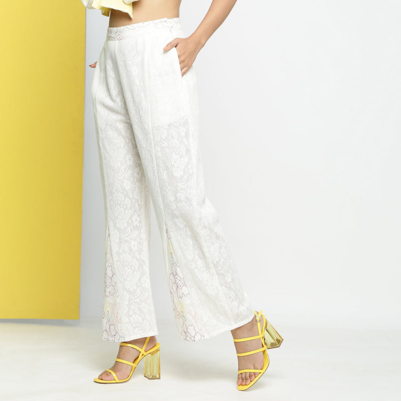Left View of a Model wearing White Cotton Schiffli Paneled Pant