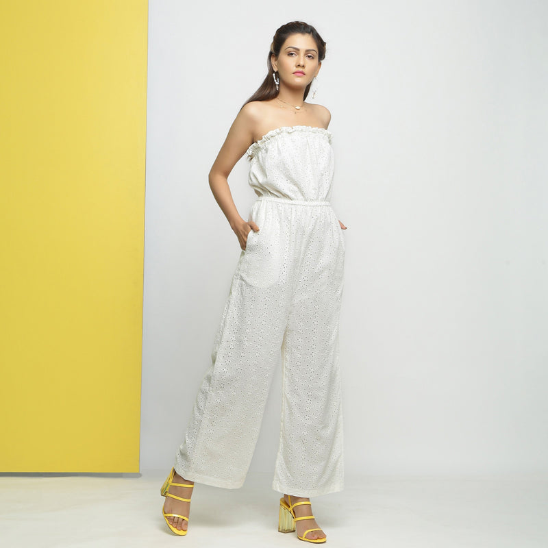 Right View of a Model wearing White Cotton Schiffli Floral Jumpsuit