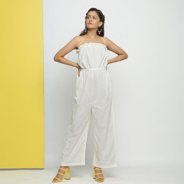 Front View of a Model wearing White Cotton Schiffli Floral Jumpsuit