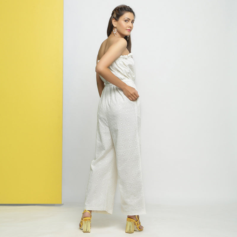 Back View of a Model wearing White Cotton Schiffli Floral Jumpsuit