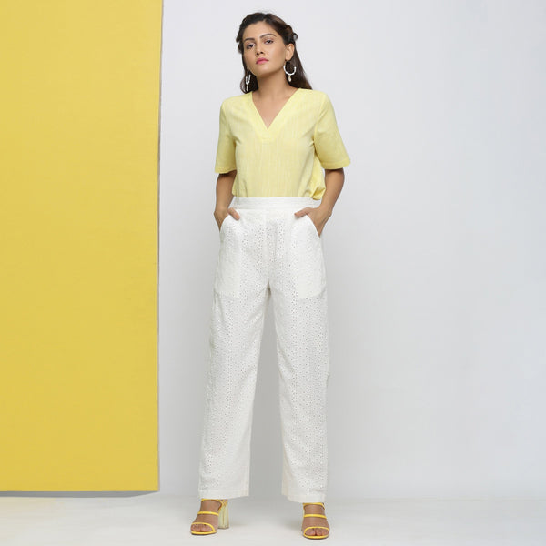 Front View of a Model wearing White Cotton Schiffli Straight Pant