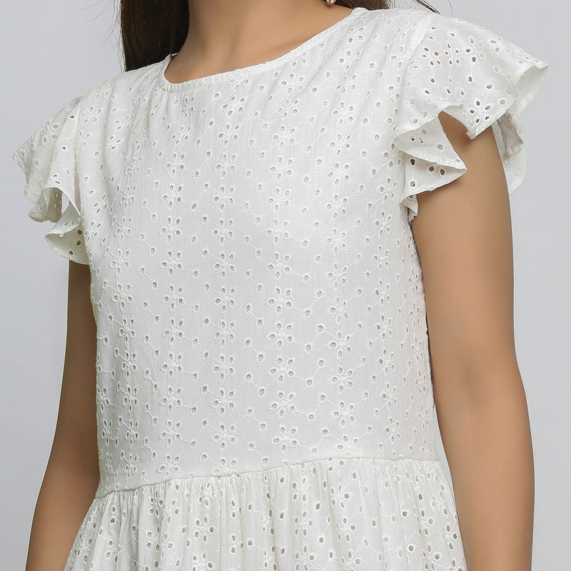 Front Detail of a Model wearing White Cotton Schiffli Short Tiered Dress