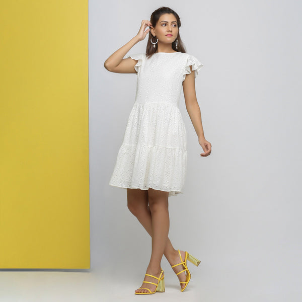 Front View of a Model wearing White Cotton Schiffli Short Tiered Dress