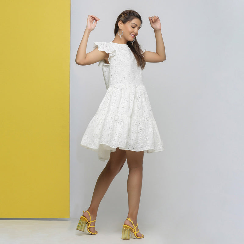 Right View of a Model wearing White Cotton Schiffli Short Tiered Dress