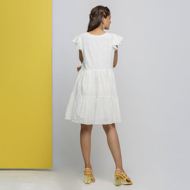 Back View of a Model wearing White Cotton Schiffli Short Tiered Dress