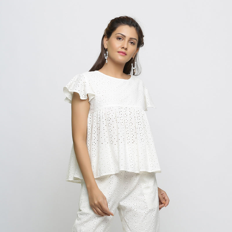 Right View of a Model wearing Off-White Cotton Schiffli Yoked Top