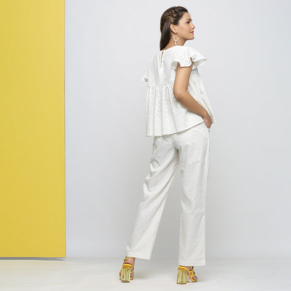 Back View of a Model wearing Off-White Cotton Schiffli Yoked Top