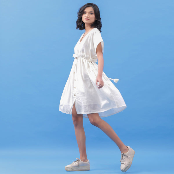 Left View of a Model wearing White Cotton V-Neck Frilled Bohemian Dress