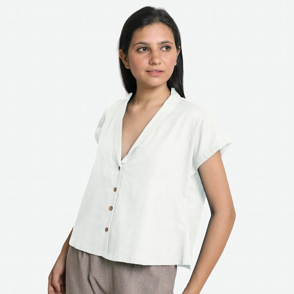 Left View of a Model wearing White Deep Neck Button-Down Cotton Top