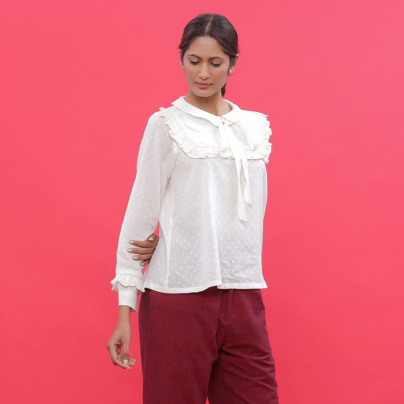 Right View of a Model wearing White Dobby Ruffled Peasant Blouse Top