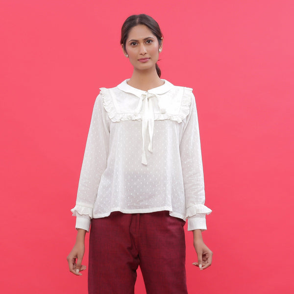 Front View of a Model wearing White Dobby Ruffled Peasant Blouse