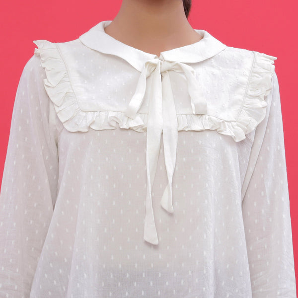 Front Detail of a Model wearing White Dobby Ruffled Peasant Blouse Top