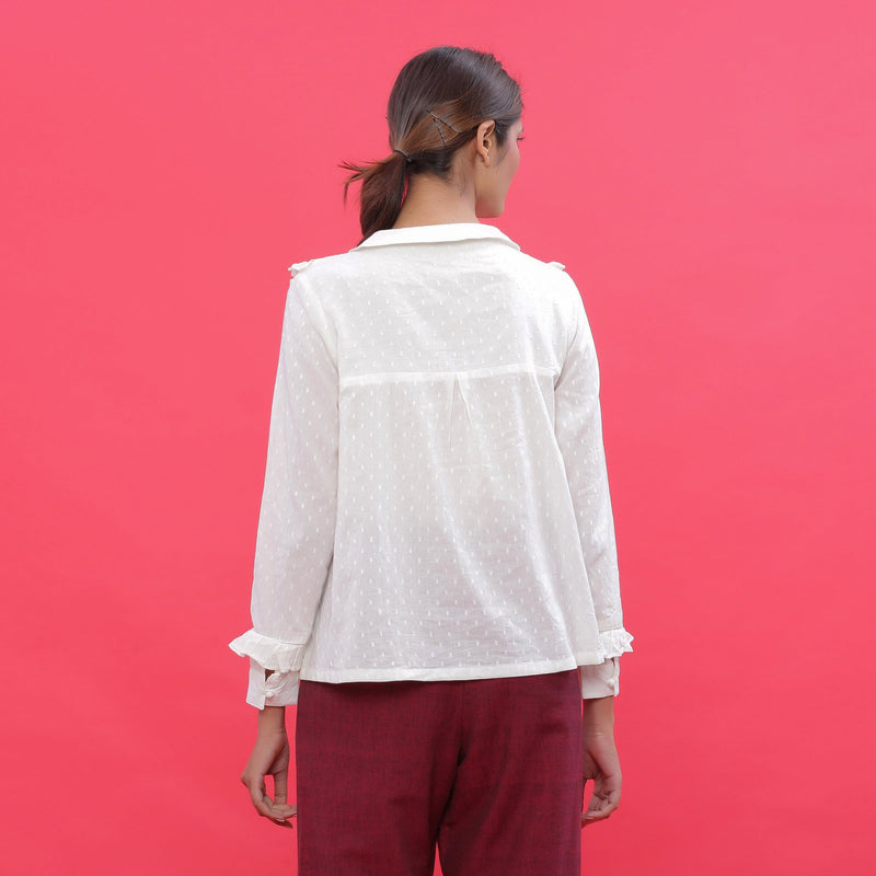 Back View of a Model wearing White Dobby Ruffled Peasant Blouse Top