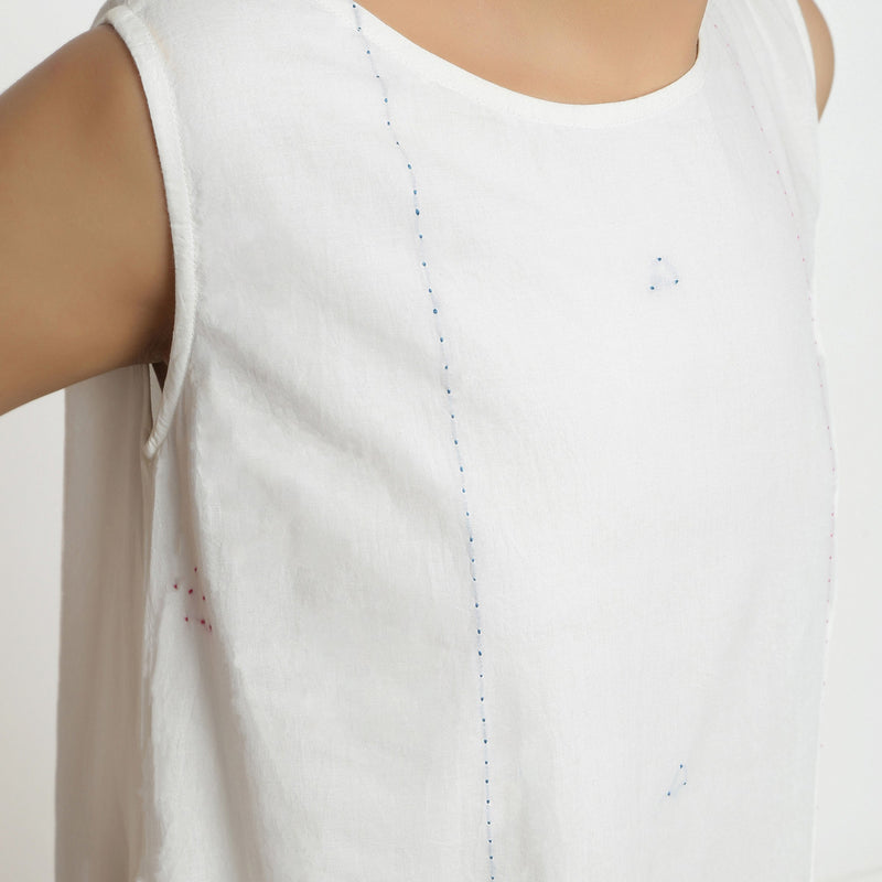 Front Detail of a Model wearing White Embroidered Cotton A-Line Dress