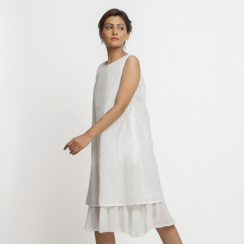 Left View of a Model wearing White Embroidered Cotton A-Line Dress