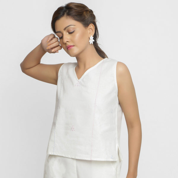 Front View of a Model wearing White Embroidered Organic Cotton Straight Top
