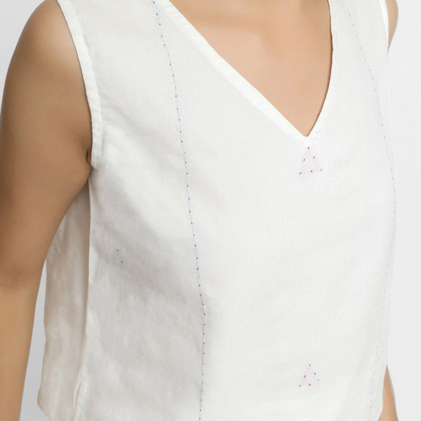 Front Detail of a Model wearing White Embroidered Organic Cotton Straight Top