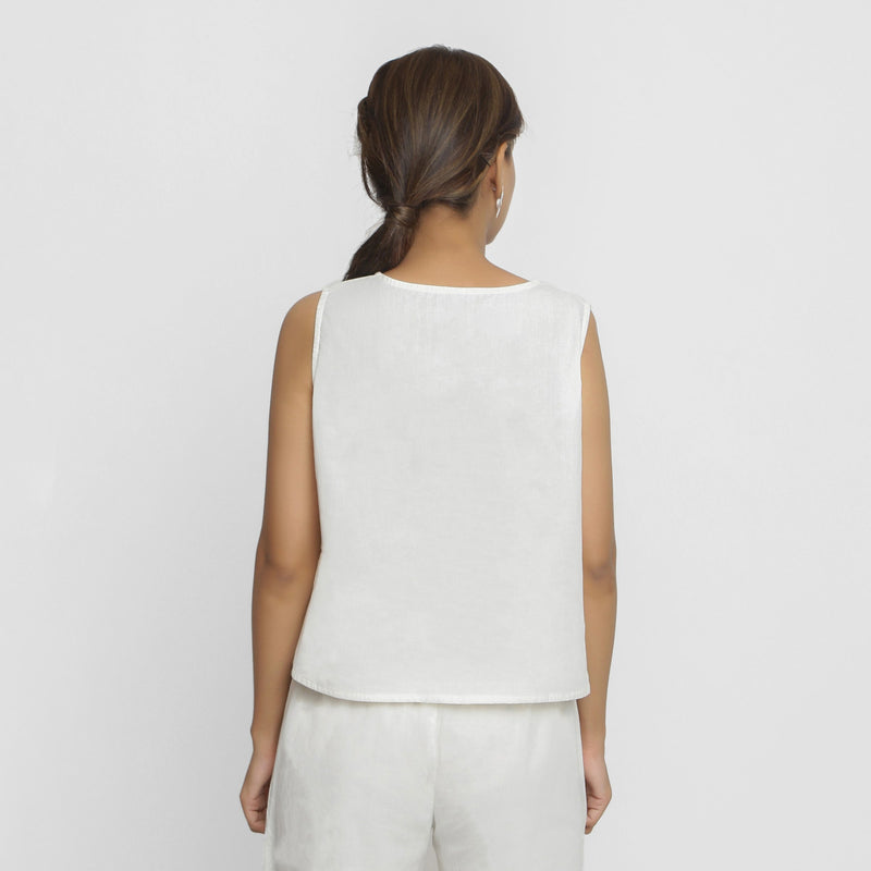 Back View of a Model wearing White Embroidered Organic Cotton Top