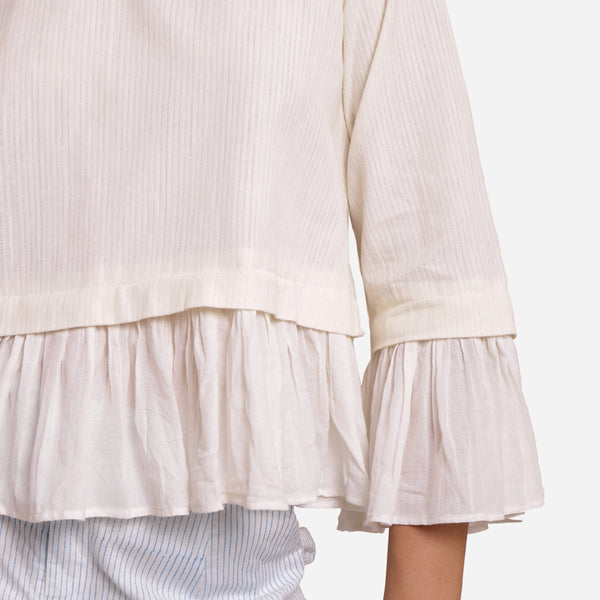 Front Detail of a Model wearing White Frilled Cotton Peplum Top