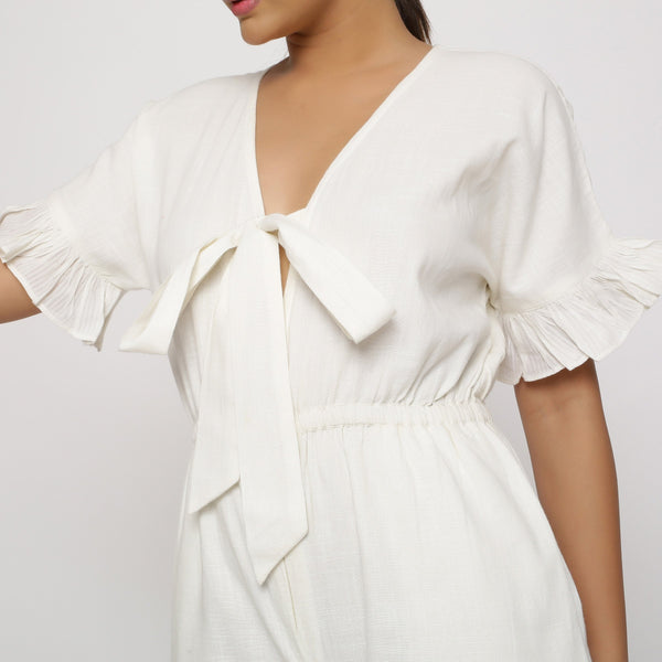 Front Detail of a Model wearing White Frilled Sleeve Cotton Playsuit